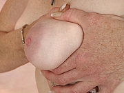 Classy MILF Effie shows her nice boobs and wet pussy