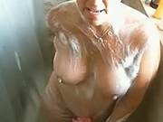 Jerk off on busty mature woman while she showers!